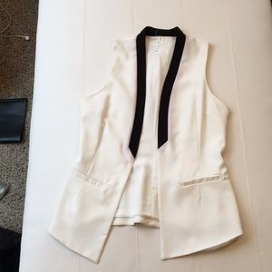 Black and cream sleeveless suit jacket